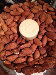 Put 3 cups of almonds into your food processor